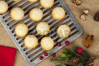 Christmas offering of fresh mini mince pies on a cooling rack