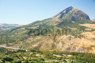 Inland landscape of inner Sicily with motorway in summer day