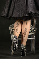 young woman with zebra high heels and chair in zebra pattern