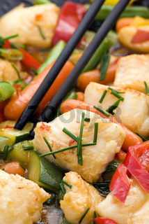 Thai Fish with Vegetable as closeup in a wok