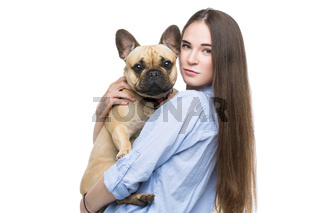 Beautiful girl holding french bulldog