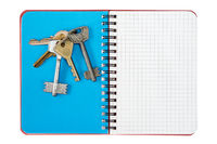 Blank notebook and bunch of keys