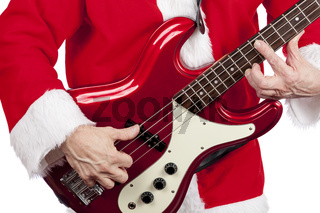 Father christmas playing a red electric bass guitar on a pure white background