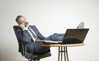 Senior business man fallen asleep at work