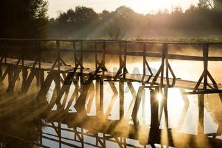 Wood bridge on the sea during sunrise