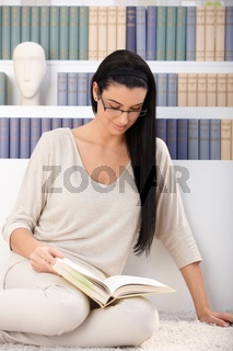 Pretty woman reading at home