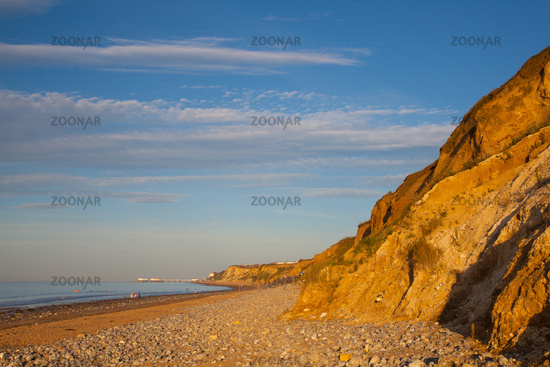 Sheringham beach and cliffs at sunset,,England