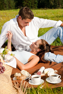 Picnic - Romantic couple in spring nature
