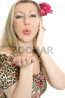 Green eyed woman blowing air kisses