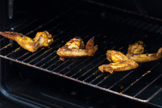 Grilled chicken wings on a metal grill