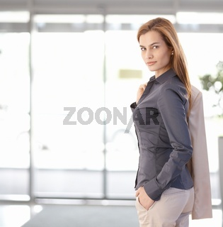 Young businesswoman leaving office