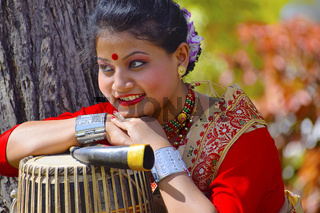Assamese girl In traditional attire posing with A Dhol, Pune, Maharashtra.