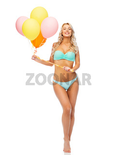 happy woman in bikini swimsuit with air balloons