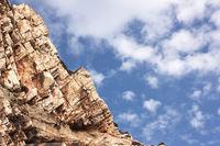 Big rock under the blue clouded sky