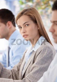 Portrait of beautiful businesswoman at meeting
