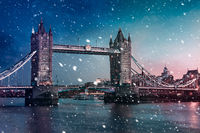 Tower Bridge  with falling snow during sunset, London, United Kingdom