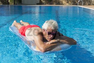 Senior man floating on water