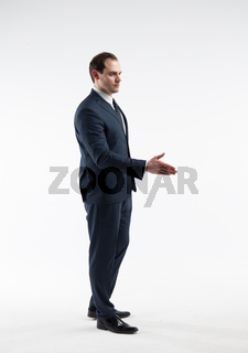 Portrait of a mature businessman make a deal isolated on white background
