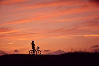 Silhouette man mountain bike Sunrise