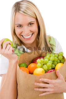 Healthy lifestyle - cheerful woman with fruit shopping bag