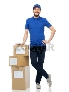 happy delivery man with parcel boxes
