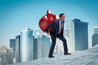 Businessman carrying the piggybank with savings