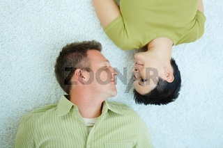Couple lying on floor