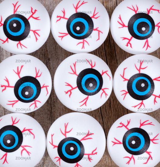 Scary eyeballs for Halloween season on rustic wood