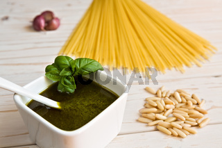 Closeup of pesto genovese and linguine pasta, pine nuts and garlic