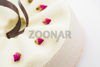 white cake with chocolate icing, food close-up