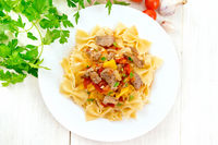 Farfalle with turkey and vegetables on light board top