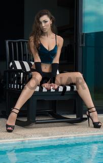 Beautiful seductive brunette woman in a luxurious villa