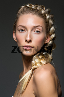Beautiful girl with braid and natural make-up