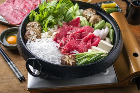 Traditional Japanese Sukiyaki with Kobe Beef as close-up in a Pot