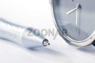 watch and pen closeup