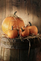 Still life with pumpkins on barrel