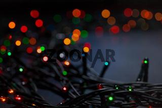 Christmas garland colorful bokeh background