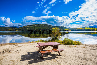 On the shore  -  table and benches for picnic