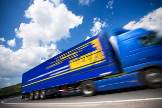 fast moving blue truck