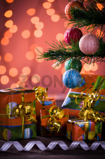 Christmas gifts with blurred lights and ribbon