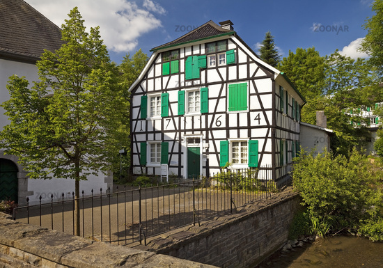 rectory of Gruiten next to the Duessel river, Haan, North Rhine-Westphalia, Germany, Europe