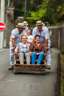 FUNCHAL, MADEIRA - SEPTEMBER 19: Traditional downhill sledge trip on September 19, 2016 in Madeira, Portugal