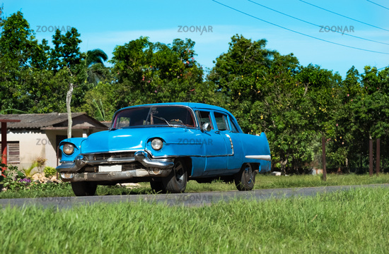 American blue classic car on the highway in Matanzas to Varadero in Cuba