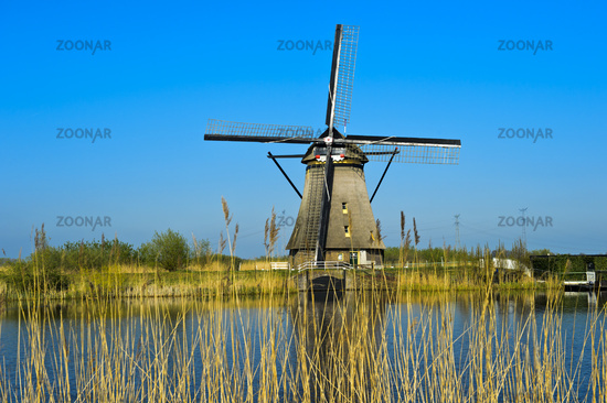 Dutch Windmill at a canal,