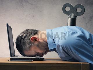 Business man sleeping on laptop