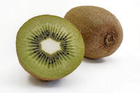 Ripe whole and halved kiwi fruit