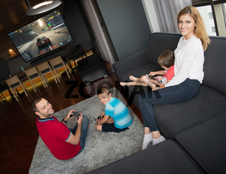 Happy family playing a racing video game