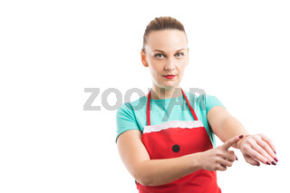 Housewife showing wristwatch as you are late concept