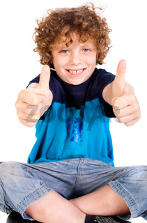 Young kid showing double thumbs up
