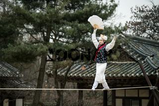 Seoul, South Korea - January 28, 2016: Acrobatics on a Tightrope walking at Korean Folk Village on January 28, 2016 in Yongin, South Korea. Korean Folk Village is a living museum type of tourist attraction.
